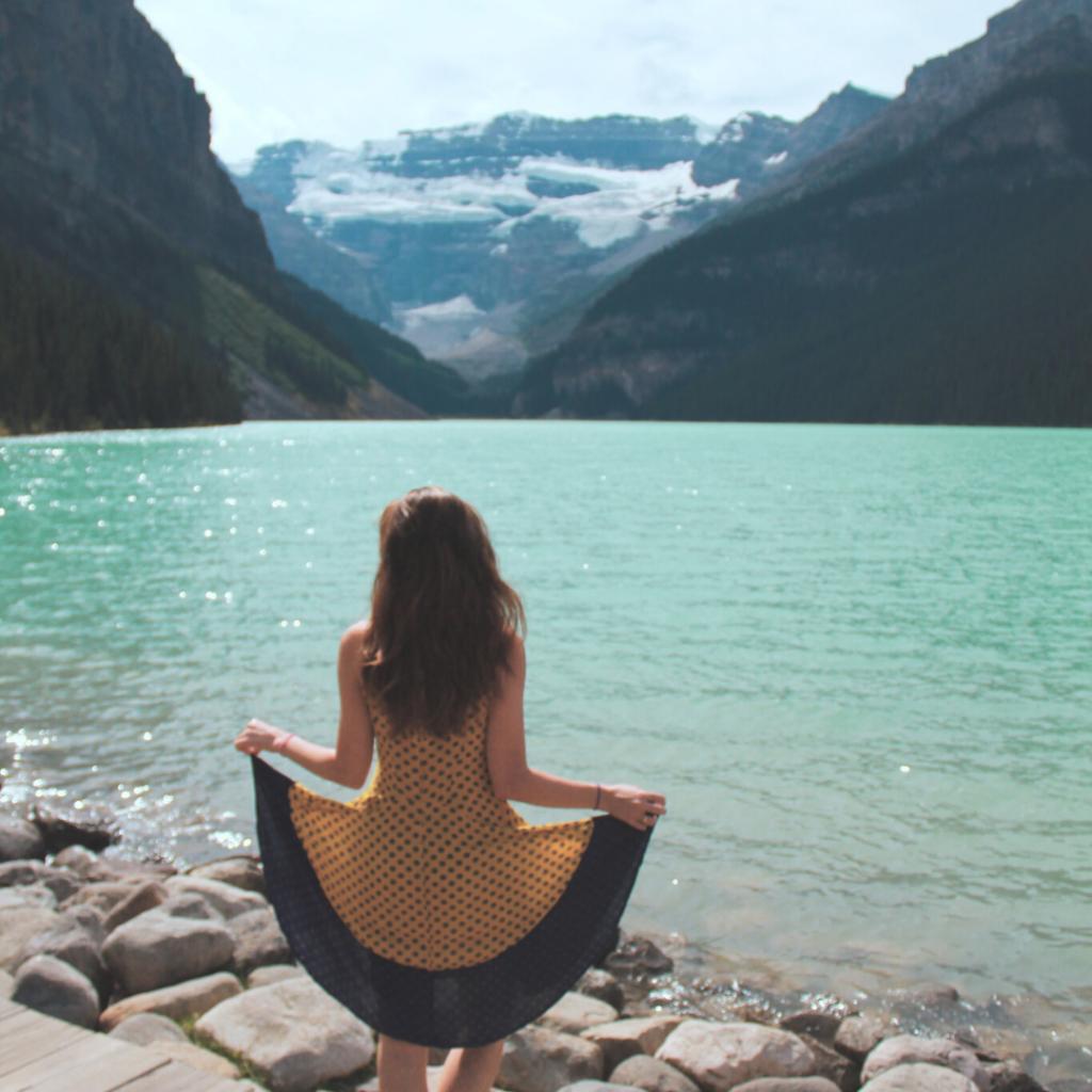 girl posing at Lake Louise lakefront
