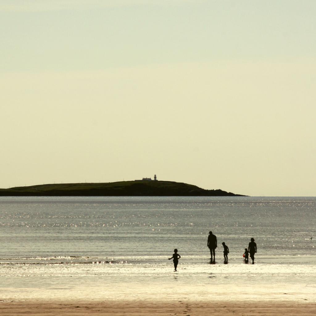 A family enjoying the gorgeous Warren beach in West Cork